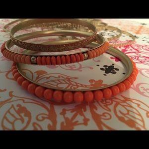 11 brass and beaded bracelets
